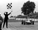 Jim Clark crosses the line to win the German Grand Prix and secure his second world title