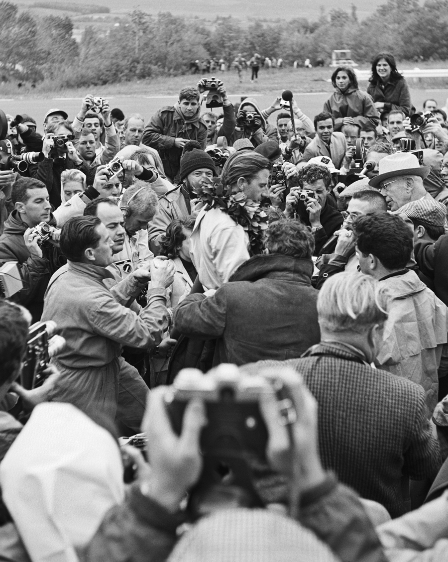 Graham Hill is mobbed after winning the US Grand Prix