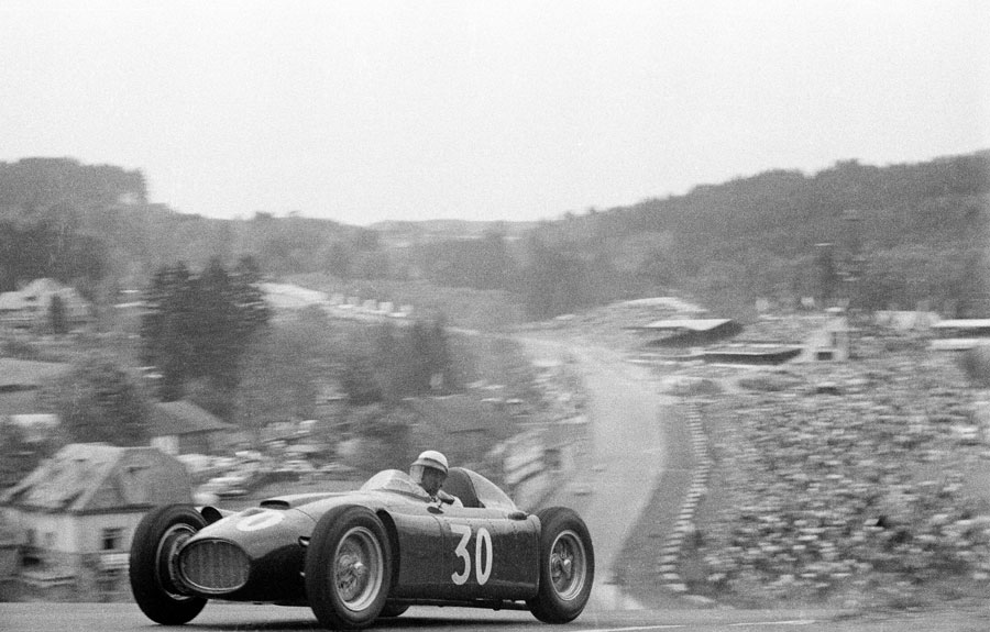 Eugenio Castellotti comes over the top