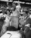 Pat Flaherty waves from the winner's circle at Indianapolis with his wife