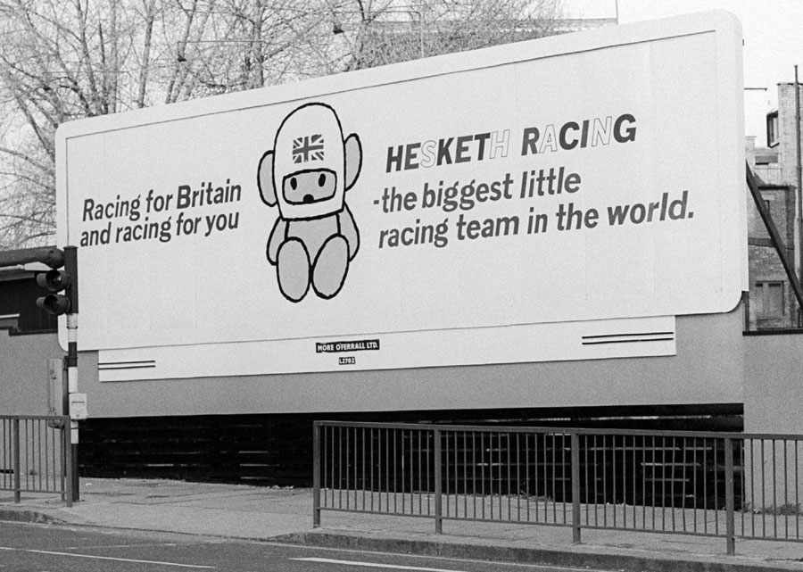A billboard advert for the Hesketh team, proclaiming itself 'The biggest little racing team in the world.'