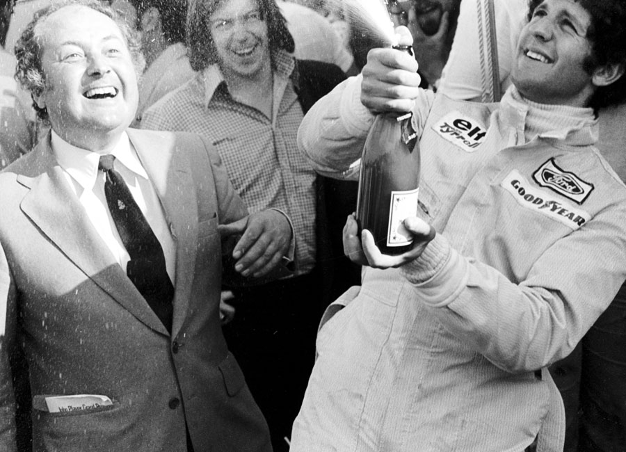 Jody Scheckter celebrates his victory after passing Niki Lauda in the closing stages of the race