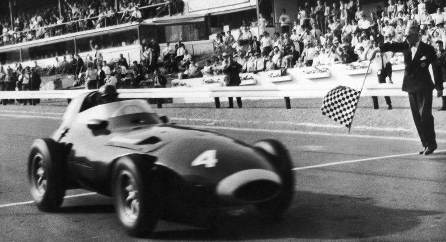 Tony Brooks takes the chequered flag to win the 1958 Belgian Grand Prix