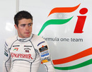 Paul di Resta takes a rest at the back of the Force India garage