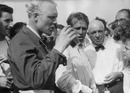 Mike Hawthorn toasts team-mate and race winner Peter Collins