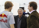 Mario Andretti shares a joke with Sebastian Vettel and Christian Horner