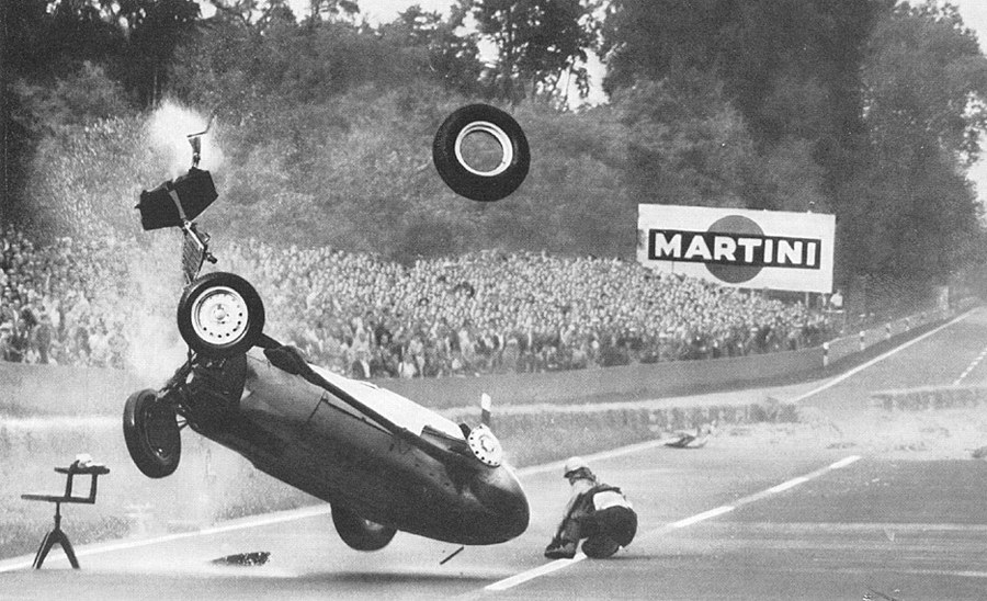Hans Herrmann watches as his BRM somersaults away from him