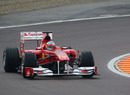 Fernando Alonso slides the Ferrari F150 during its first run on wet tyres