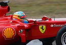 A close up of Fernando Alonso tackling the tight Fiorano test track in the new Ferrari F150