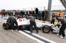 The new Sauber C30 is wheeled back to the pits