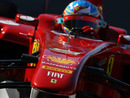 Fernando Alonso on track in the Ferrari F150