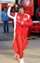 Fernando Alonso waves to fans as he heads home