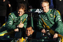 Tony Fernandes poses for photos with Jarno Trulli and Heikki Kovalainen