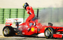 Felipe Massa clambers out of his Ferrari after it caught fire 35 minutes into the final day of testing