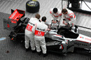 Mechanics assemble the new MP4-26 in Berlin's Potsdamer Platz