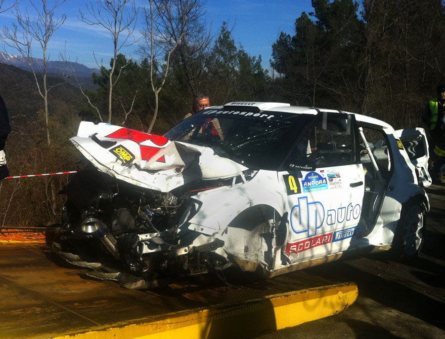 The remains of Robert Kubica's wrecked Skoda Fabia are towed away