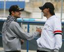 Tonio Liuzzi greets Robert Kubica in the paddock