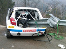 The remains of Robert Kubica's wrecked Skoda Fabia with a guard rail piercing the chassis