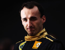 Robert Kubica poses for photos at the launch of the Renault R31