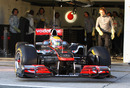 Lewis Hamilton leaves the garage in the brand-new McLaren MP4-26