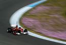 Felipe Massa at speed in the Ferrari F150th Italia