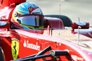 Fernando Alonso at the wheel of the Ferrari F150th Italia