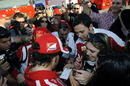 Fernando Alonso is mobbed by fans at the end of the day