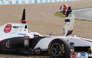 A rueful Kamui Kobayashi looks at his Sauber as it sits in the gravel