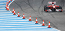 Fernando Alonso heads past the cones