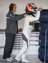 Kamui Kobayashi receives a back rub in the Sauber garage