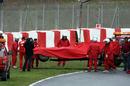 Felipe Massa's Ferrari is retrieved from the gravel