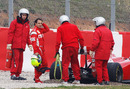 Felipe Massa waits for his Ferrari to be lifted out of the gravel