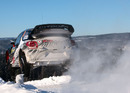 Kimi Raikkonen flies over a jump in his Citroen DS3