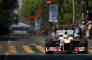 Sergio Perez drives his Sauber during a demonstration on the streets of  Guadalajara