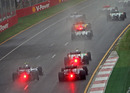 Cars battle for position in the wet