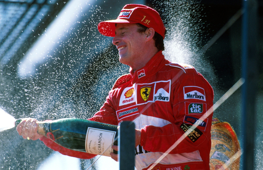 Ferrari's Eddie Irvine celebrates his win at Melbourne