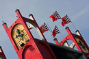 Ferrari flags fly from the top of the Imola tower