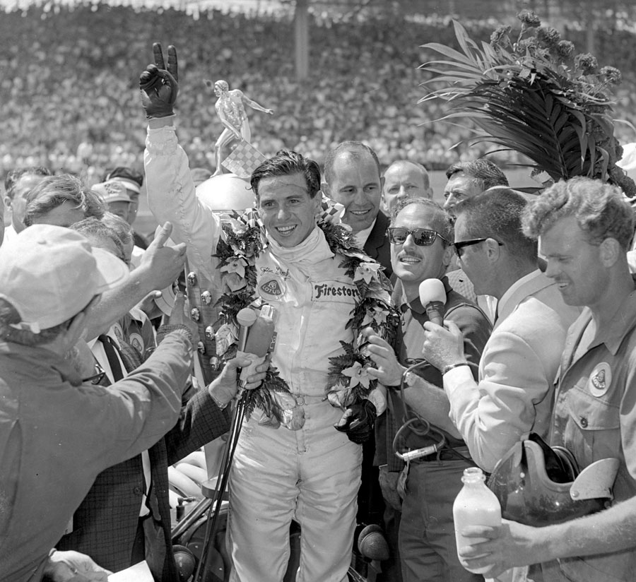 Jim Clark celebrates victory on US soil after winning the Indianapolis 500 at his third attempt with Lotus