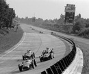 Stirling Moss with the offset-engine Maserati 250F leads the field at Monza