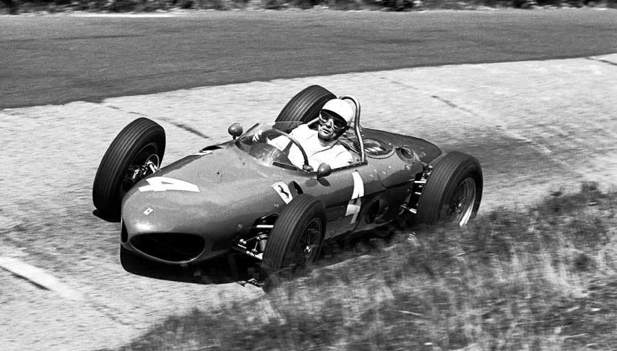 Phil Hill driving a Ferrari 156 Sharknose