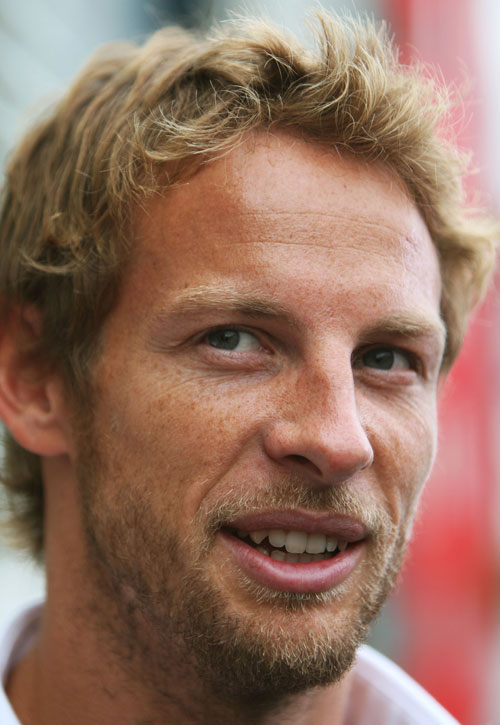 Jenson Button talks to the media
