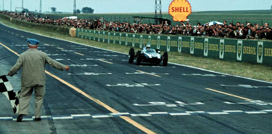 Jack Brabham crosses the line to win