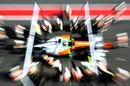 Force India go to work on Paul Di Resta's car in the pits
