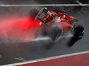 Fernando Alonso splashes down the pit lane at the Circuit de Catalunya