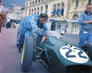 An exhausted Innes Ireland trying to push his Lotus 18 up the hill at Monaco