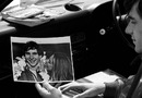 Ayrton Senna looks back at a photo from his first victory of the season