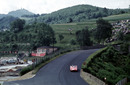 Phil Hill drifts the Ferrari TR/59 over Adenau Bridge at Breidscheid