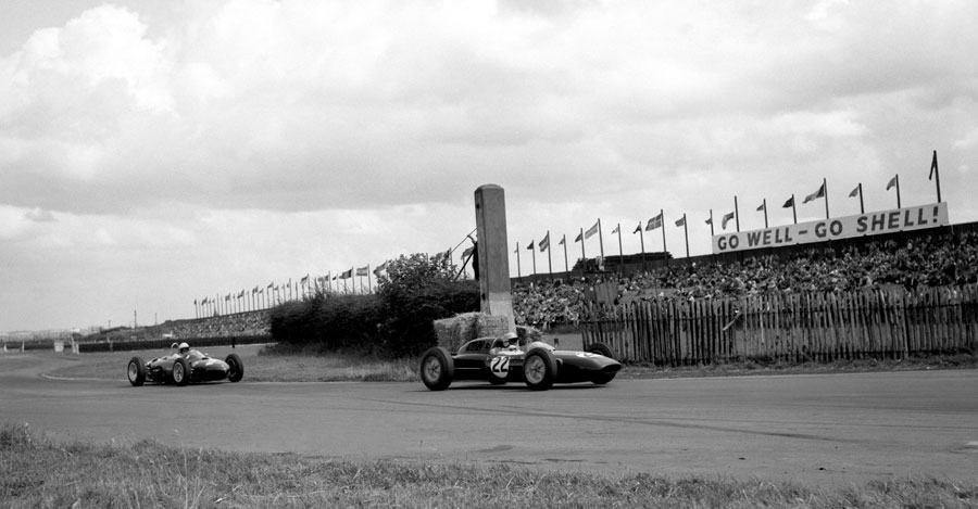 Trevor Taylor in a Lotus followed by Phil Hill in a Ferrari