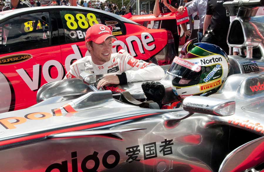 Jenson Button swaps cars with Craig Lowndes for a lap of the Bathurst track