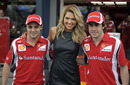 Felipe Massa and Fernando Alonso pose for photos with Australia Grand Prix ambassador Ashley Hart